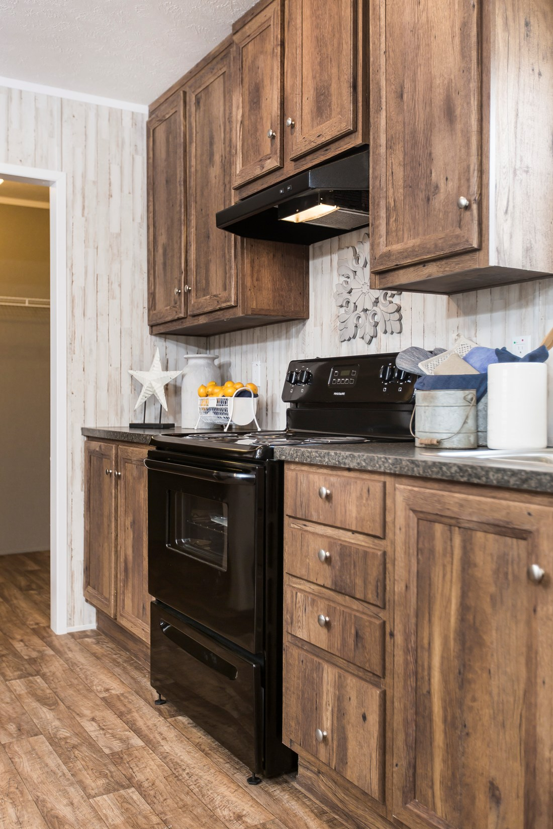 "The NOW28603U ""NOW ULTRA"" Kitchen. This Manufactured Mobile Home features 3 bedrooms and 2 baths."