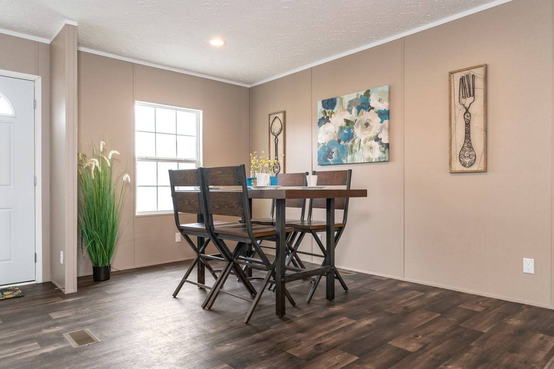 The ISLAND BREEZE Dining Area. This Manufactured Mobile Home features 3 bedrooms and 2 baths.