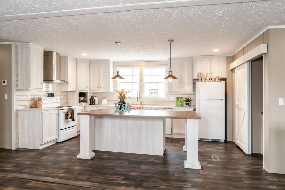 The ISLAND BREEZE Kitchen. This Manufactured Mobile Home features 3 bedrooms and 2 baths.