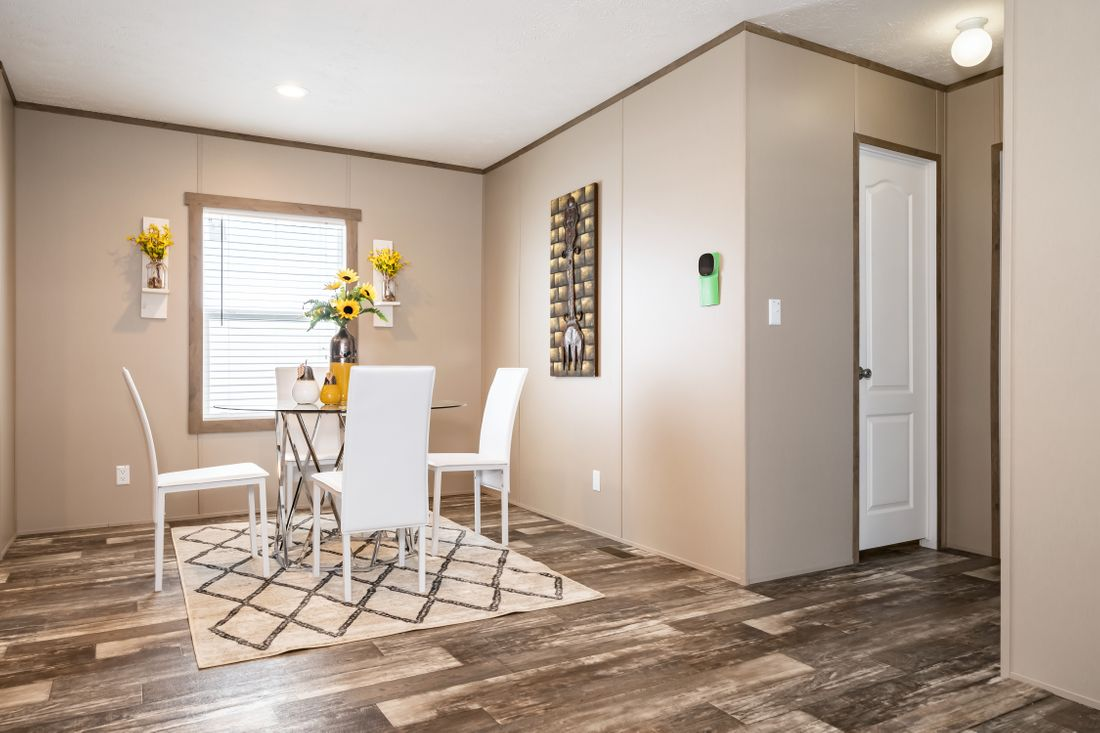 The ULTRA PRO 52 Dining Area. This Manufactured Mobile Home features 3 bedrooms and 2 baths.