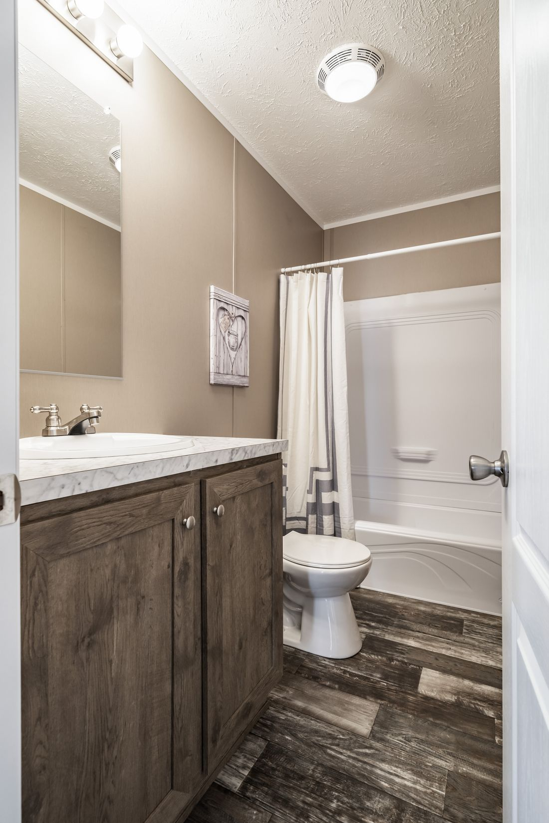The ULTRA PRO 52 Guest Bathroom. This Manufactured Mobile Home features 3 bedrooms and 2 baths.