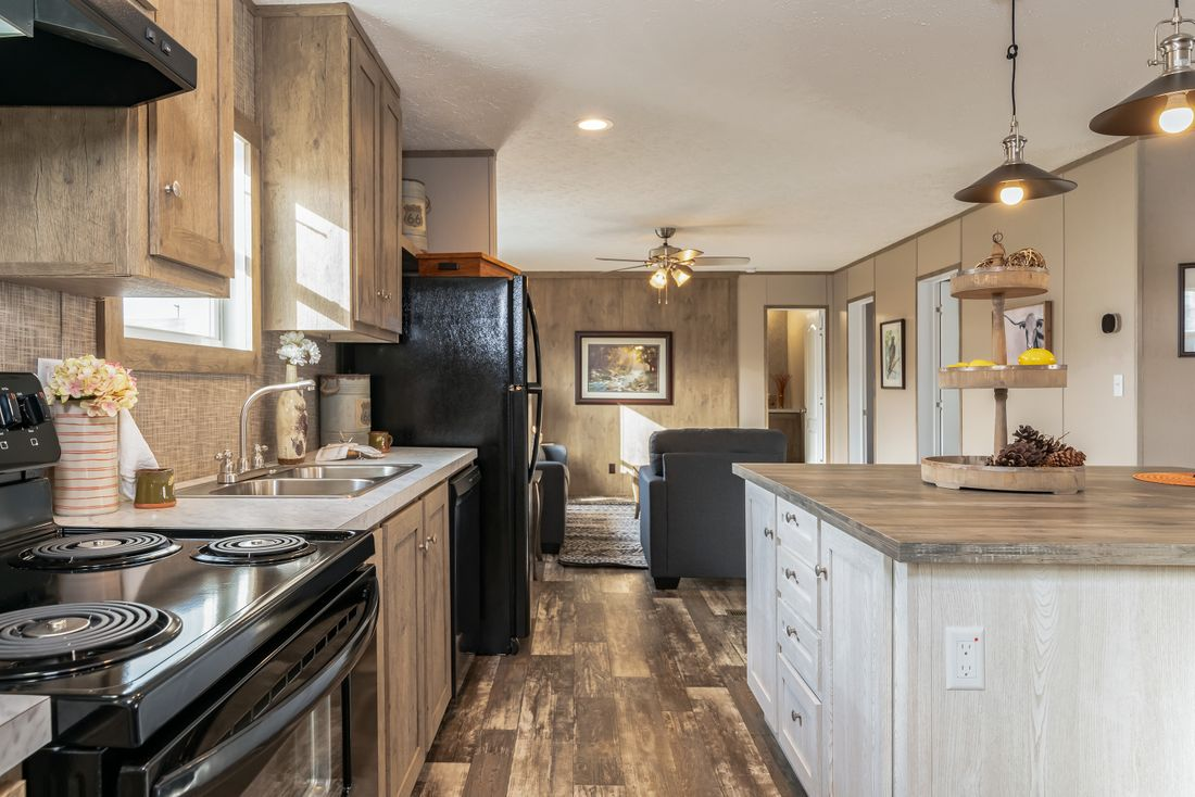 The ULTRA PRO 56B Kitchen. This Manufactured Mobile Home features 3 bedrooms and 2 baths.