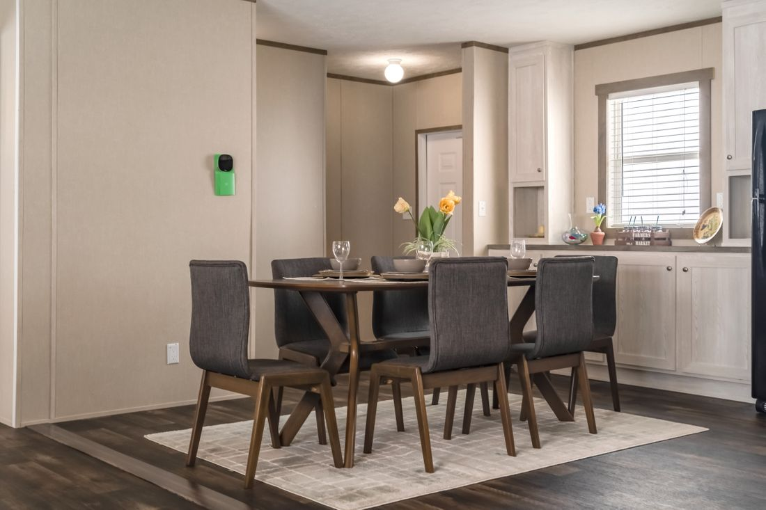 The ULTRA PRO 56A Dining Area. This Manufactured Mobile Home features 3 bedrooms and 2 baths.