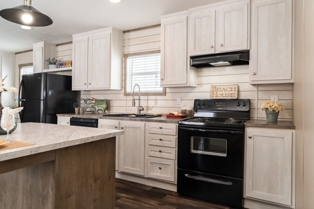 The ULTRA PRO 56A Kitchen. This Manufactured Mobile Home features 3 bedrooms and 2 baths.