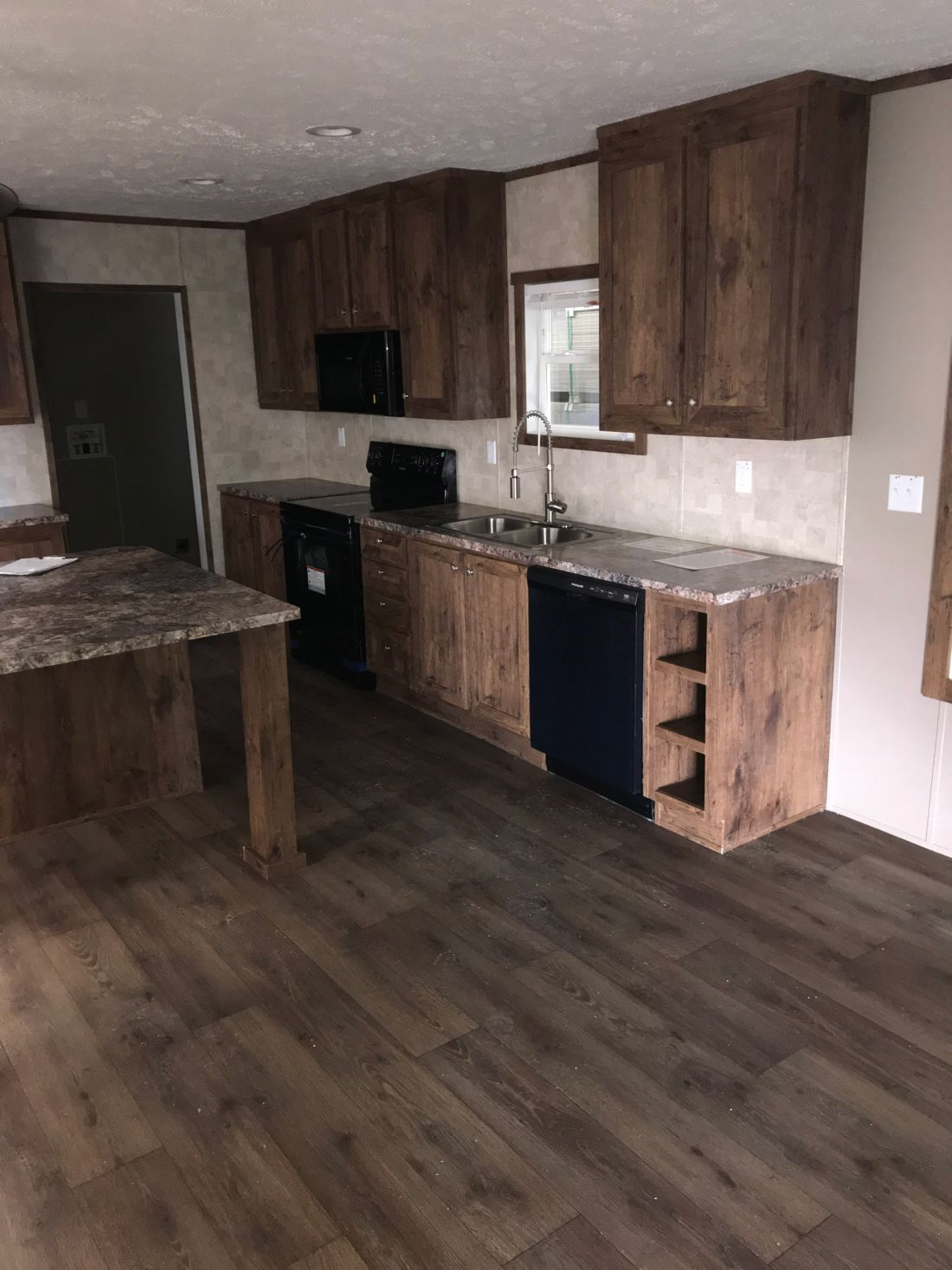 The ULTRA PRO 76 Kitchen. This Manufactured Mobile Home features 4 bedrooms and 2 baths.