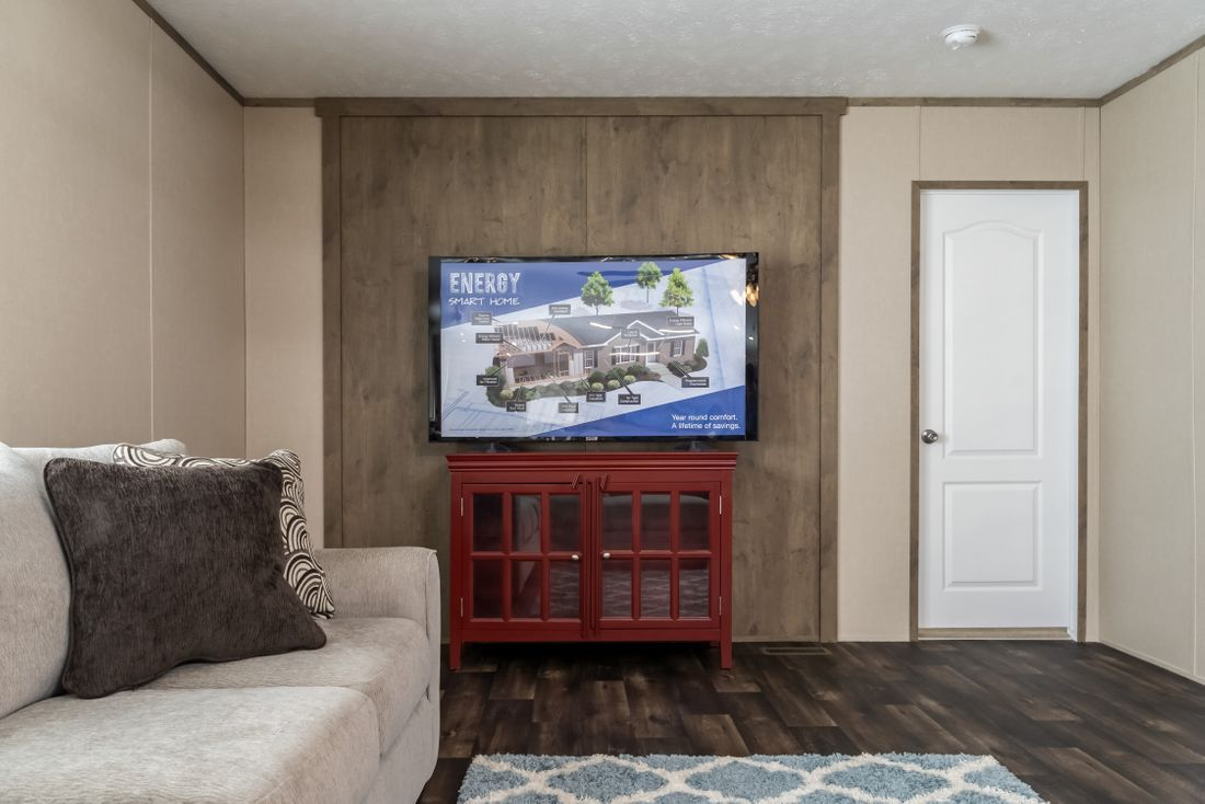 The ULTRA PRO 76 Family Room. This Manufactured Mobile Home features 4 bedrooms and 2 baths.