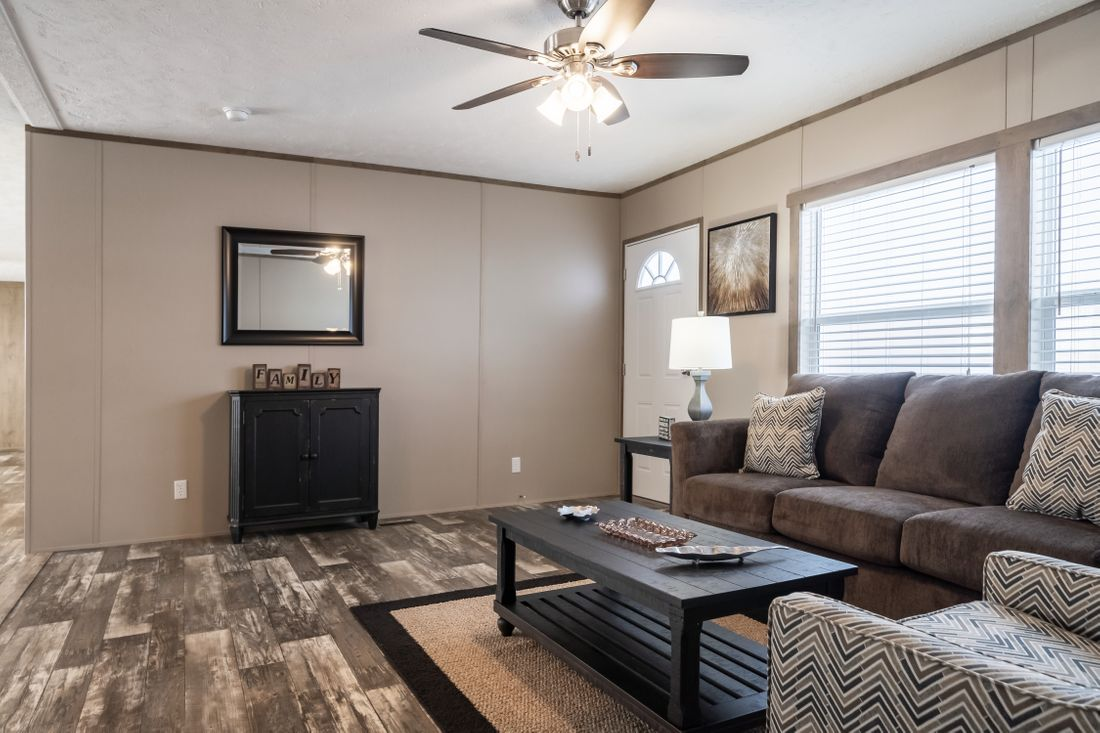 The ULTRA PRO 60 Family Room. This Manufactured Mobile Home features 3 bedrooms and 2 baths.