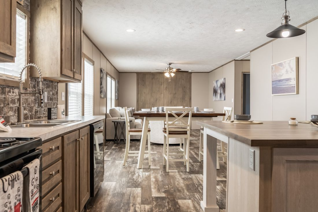 The ULTRA PRO 60 Kitchen. This Manufactured Mobile Home features 3 bedrooms and 2 baths.