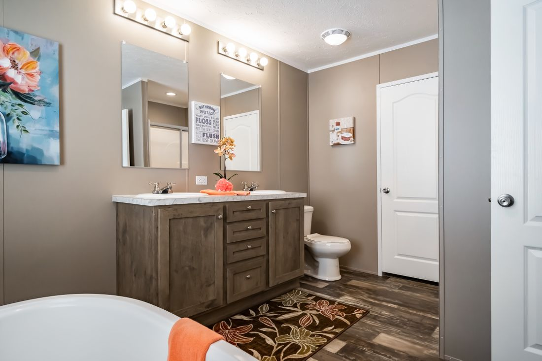 The ELITE THE ANSWER 28X60 Master Bathroom. This Manufactured Mobile Home features 3 bedrooms and 2 baths.