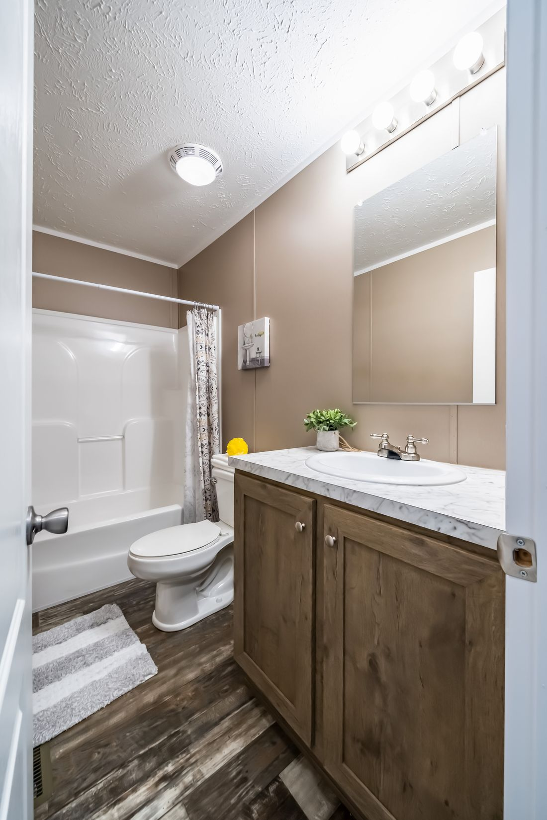 The ELITE THE ANSWER 28X60 Guest Bathroom. This Manufactured Mobile Home features 3 bedrooms and 2 baths.