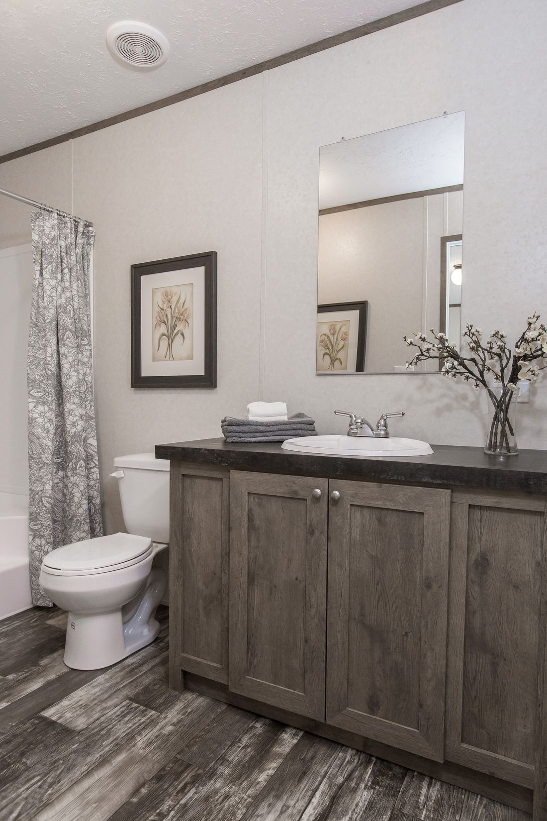 The THE NEW BREEZE I Master Bathroom. This Manufactured Mobile Home features 3 bedrooms and 2 baths.