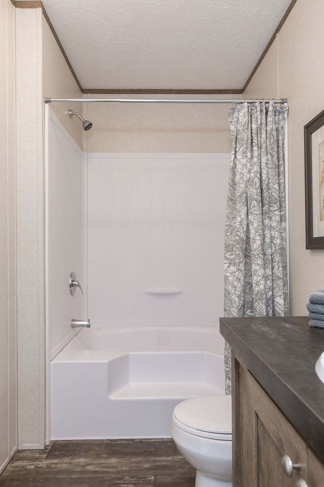 The THE NEW BREEZE I Guest Bathroom. This Manufactured Mobile Home features 3 bedrooms and 2 baths.