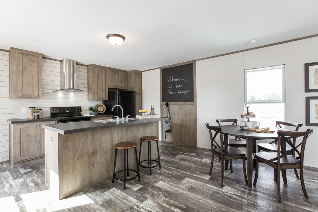 The THE NEW BREEZE I Kitchen. This Manufactured Mobile Home features 3 bedrooms and 2 baths.